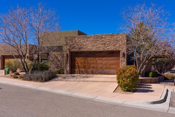 The Legends is a High Desert luxury gated community. This Safe Family oriented neighborhood is a Homeowners Dream. The kids can play outside, while entertaining in this stunning SW modern home featuring natural landscape, beautiful tall ceilings, wood floors, remote controlled gas log fireplace built to relax you, and access to the west facing balcony with built-in Wolfe BBQ grill great for entertaining! The gourmet kitchen features Sub-Zero refrigerator, Wolfe appliances, granite counter tops, lots of light and theirs plenty of storage! The entire home has gorgeous stacked stone inside and out along with gorgeous wood cabinetry and custom acrylic plaster walls. Master bedroom has balcony access and a luxurious over sized shower with multiple shower heads! The bonus is in the views! SFYS