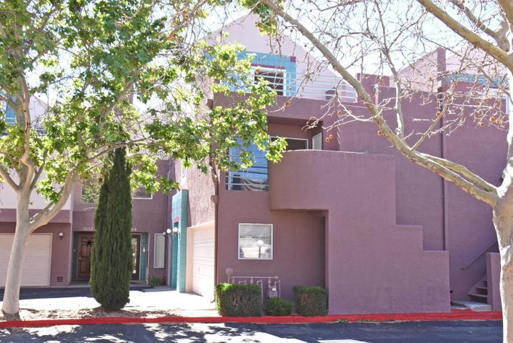 Beautiful home in upscale condominium complex in the desirable NE heights. Sunset and forever views to the west and of the Sandias and open space to the east. Pick any one of the 3 spacious balconies to enjoy your outdoor living. Step out your front door to nearby walking and biking trails. Close to shopping and restaurants. Light and bright with vaulted ceilings and great architectural lines. Freshly painted. HOA covers pool, clubhouse, streets, exterior stucco, roof and some utilities.