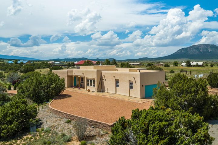 Welcome to this Stunning, Southwestern-Style, Single-Story Country Estate Nestled on 6.5 Pristine Acres in Edgewood, NM! 19 Hawkeye Road features a New TPO Roof (with Transferrable Warranty) and New Stucco on both the Main Home and the Studio/Workshop! This Home offers an Open Floor Plan, Lots of Natural Light, and Breathtaking Mountain Views for Miles! Graced by Soaring Tongue & Groove Wood Viga Ceilings and a Wood Burning Kiva Fireplace, 19 Hawkeye features an Updated Kitchen with Granite Countertops, Stainless Appliances, Island, and Breakfast Nook. Luxurious Master Suite with Double Sinks, Jetted Tub, and Separate Shower. Newer Detached Building on the Property can be an Art Studio, Workshop, or Storage Area. 4 Garage Spaces! 2-Car Garage at Main Home, 2-Car Tandem Garage at Casita!