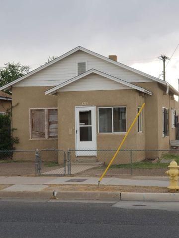 Cute little downtown bungalow close to all the downtown amenities -  2 bedrooms, 1 full bath, walk in closet, laundry hookups - spacious kitchen and living room.  Enclosed porch and basement (neither included in sq ft).  1 car garage plus gated/enclosed/off street parking.  Entire yard  is fenced.  Walking distance to downtown and close to UNM.  Home Is Here!