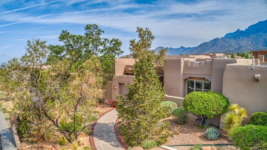 Timeless Elegance & Beauty Abound in this Wonderful High Desert Home! Iconic Southwest Contemporary Design, Charming yet Sophisticated, Spacious yet Cozy, Content & Finishes Rich with Warmth, Quality, & Soul. A Peaceful Courtyard with Koi Pond Sets the Tone. A Grand Entry opens to a Panorama of Windows, yielding Mountain & Valley Vistas. The Kitchen Beckons the Savviest of Cooks & offers Dramatic Focal Point with High End Finishes & Appliances, Wine Station, Inviting Nook, & Outdoor Kitchen & Living with Old World Decor just steps away. Functional Floor Plan with All the Owner Needs on the Main Level. Lower Level Game/Family Room with Theater, Bar, & Bedrooms Expand the Entertaining & further House the Family in Comfort. Recent Significant Updates, TPO Roof, & Stucco. Quite a Masterpiece!