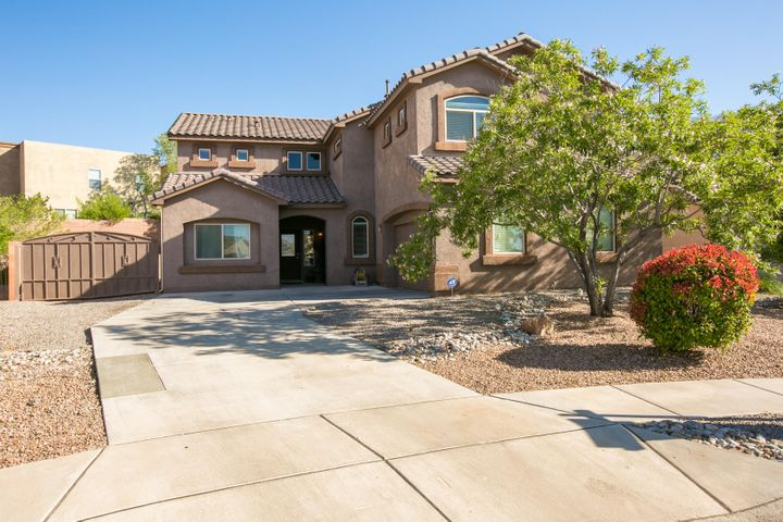 Cabezon Beauty back on the market due to buyers financing falling through! Bright and open floor plan with 5 bedrooms, 3 living spaces and a beautifully landscaped backyard!  The downstairs offers a 2nd master suite, 2 large living areas, office and a large open kitchen with breakfast nook.  Upstairs, is the Master Suite, 3 additional bedrooms, another living room, plus a large balcony that over looks the oversized yard.  There is backyard access for a trailer/boat or extra storage as well as a nice size storage shed.