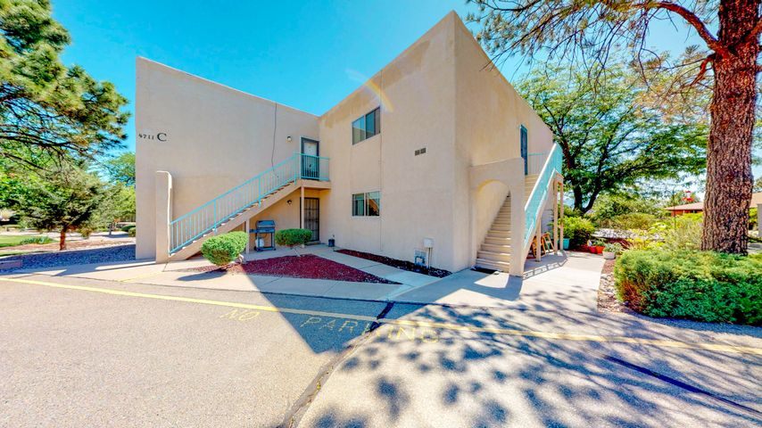 This charming condo offers a spacious open floorplan with lots of natural light, great size one bedroom, one bath, Refrigerated air, great private balcony with spectacular views of the Sandia Mountains.  Close distance to golf course, nestled in the Paradise View Condominiums, Refrigerated air. Gas and water included in HOA fee. Come see it before its gone!