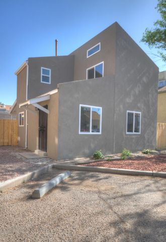 Beautifully update home near UNM!  Updates include: New wood laminate flooring and carpet in bedrooms, completely remodeled kitchen with all new appliances/cabinets/counter tops/sink, new stucco, new windows and a new new bath! This one shows like a model! Hurry before its gone!