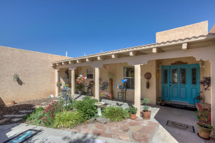 This Beautiful, Secluded Home is located in the prestigious Crest View subdivision in the Village of Los Lunas. The Home sits on almost a half an acre with three bedrooms two and a half baths, two living areas, two open patios, courtyard, backyard access and a detached structure that can be used as another garage, art studio or converted into that extra space for company. The roof on the Home was replaced in 2016, water heater replaced in 2015 and the detached structures tpo roof was replaced in 2018. The Home has two evaporate cooling units for fresh air all summer. This Home is your Dream and it is waiting for you.