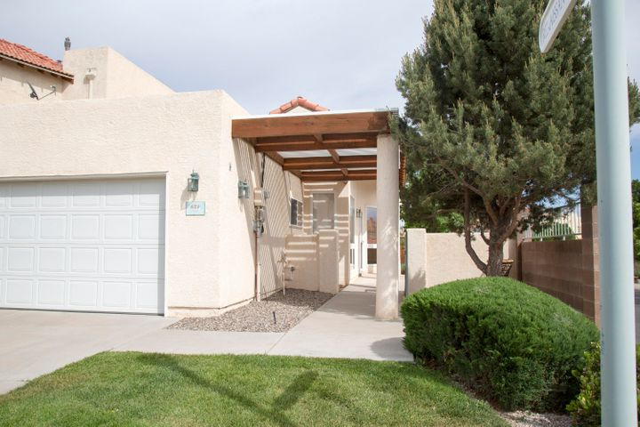 A lovely and hard to find 2 bed/2 bath townhouse in a private gated community. Located on a corner lot this home features an open concept living area with a gas fireplace and AC.  A light and bright home with glass block, skylights and beautiful windows. The large master suite has a fully outfitted walk-in closet including built-in drawer storage! The spacious master bath includes two separate vanities, a beautiful jetted tub and separate shower. The laundry room is centrally located with lots of storage; washer and electric dryer are included. The cheery kitchen is open to living and dining areas. The kitchen has abundant storage and all appliances convey. A wonderful lattice covered deck sits in the backyard with a view with lighting and electrical outlets. Perfect for relaxing.