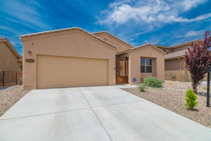 Beautiful One Story Home built in 2017 by Twilight Homes is located in the heart of Los Lunas and only minutes away from I-25!  With 1818SF this ''Orion'' floorplan has 3 BR's, 2BA's, 2CG, an open kitchen with beautiful dark wood cabinetry built by Davis Kitchens, granite countertops, SS Appliances (all stay), W/D stay too!! Large living room and dining room! 2 X 6 Construction, tankless water heater, REF Air!! Gorgeous Custom Made Security Door!!  ADT Security System, 2 Security Cameras and Ring Doorbell all stay!! Beautiful Custom back yard Landscaping which includes steps up to the top of the angled backyard and has a flagstone deck that has amazing views of the Sandias and Monzano Mountains!! Covered Patio too!  Enjoy the Stella Cherry, Bartlett Pear and Apricot trees! So much more!!