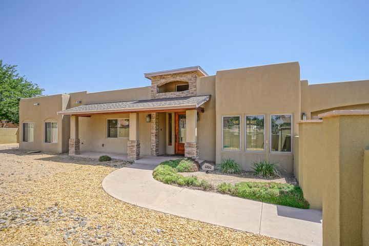 Stunning Corrales Home situated on a 1/2 acre Corner Lot - Pride of Ownership is evident! Home features a spacious Living Area with Raised Ceiling. The Gourmet Kitchen is every Chef's dream, boasting Custom Cabinets, gorgeous Granite Tops, Farmer's Sink,SSteel Appliances, Huge Island with Garden Sink.  Master Bath offers an updated Shower, Master Closet features a full California Closet!  Newer Front Yard Wall installed for privacy, RV Pad added on the side of home as well. Backyard recently landscaped, perfect for BBQs & entertaining! Covered Patio off the Dining Area creates additional outdoor Living Space to enjoy.  Backyard access available, too. A functional property for Horse/Animal Lovers with 2 high-fenced pens. Close to ABQ Shopping in the Cottonwood Mall Area! A MUST SEE Home!