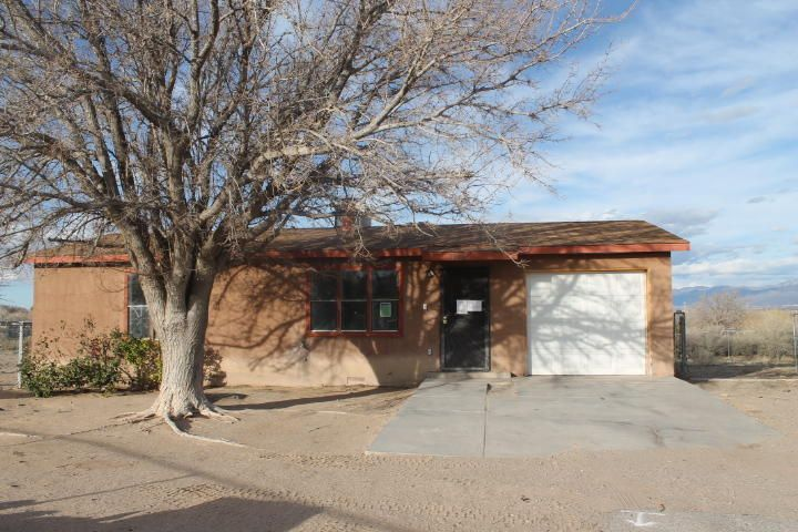 Cute 2 bedroom 1 bathroom home that sits on a large lot. The property has a cozy living room and kitchen with dining area. There is a separate laundry room and a 1 car garage. The property also has back yard access and amazing unobstructed views of the Sandia Mountains.