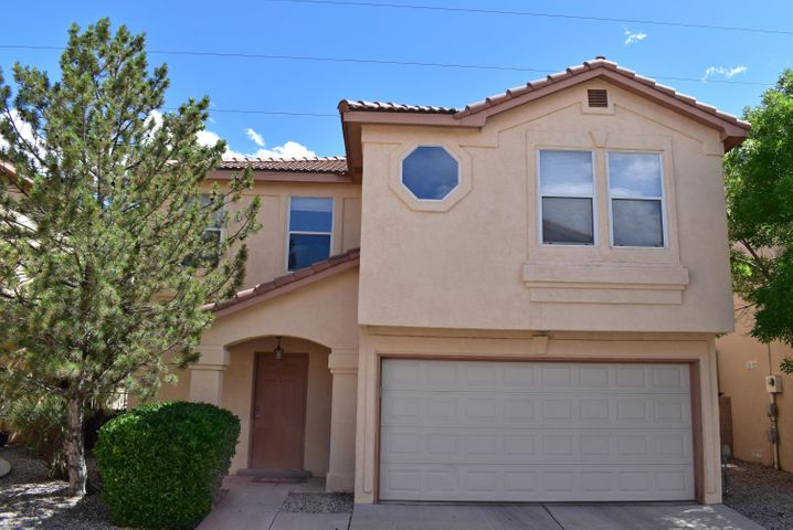 Gated community within easy commuting distance to UNM. Appealing open floor plan with eat-in  kitchen opening to living area and back yard patio.  Tile and laminate floors downstairs. 1/2 bath downstairs. Large 2nd living area upstairs with master bedroom separated from second bedroom.  Laundry room upstairs = washer and dryer stay (no warranties).  Walk-in closets.  Attached 2 car garage. Dog friendly community with park in the center of the complex.