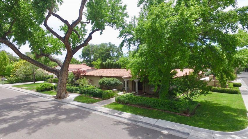 Spectacular residence in the heart of the Albuquerque Country Club neighborhood. Nestled under  trees on a large corner lot, this beautiful home has been impeccably maintained with only the best in quality and style, with custom features and finishes throughout.