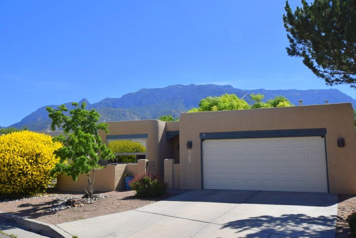 Fabulous location for this one level, well designed Roger Smith built home.  Conveniently located home w/ view of the Sandia Mountains,  & situated on a cul-de-sac.  Courtyard entry, 3 BR , 2 BA , 2 car gar. home w/ high ceilings,  wood floors, natural light.  GR w/corner kiva FP, & access to the lush backyard!  Kitchen boasts granite counter tops, SS appliances,  backsplash &  deep sink.  Formal or casual dining.  MBR w/east light,  walk in closet, sep. shower & tub, plus a walk-out to private backyard.  Both  bathrooms have been remodeled. A few newer items are: insulated garage door,  garden  style landscaping, exterior paint, water heater, windows, doors, wood flooring, interior paint.  Storage in backyard.  Enjoy the Tramway Trail system.  A great property to call home.