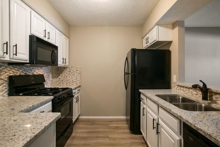 Fully remodeled with new paint, carpet, AquaGuard laminate wood floors, stack stone fireplace, granite countertops, custom backsplash, appliances, and new lighting. Water heater is brand new. Custom tile shower and floors. Turn key!