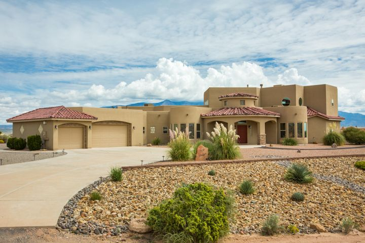 Don't miss this beautiful custom home in Rio Rancho Estates. Incredible, unobstructed views of the mountains, city lights, & surrounding areas. This functional, open concept floorplan is light & bright~ so many windows! Large main living area w/ custom gas fireplace. Gourmet kitchen bodes stainless appliances, granite counters, custom tile backsplash, two sinks, island, walk-in pantry, & plenty of seating. Perfect for entertaining! Main level master is huge, offers backyard access (straight out to the hot tub!), walk-in closet, large master bath w/ his & hers vanities, jetted tub, & large walk in shower. Nicely sized secondary bedrooms. Large loft w/ balcony & 3/4 bath.  Huge covered patio w/ fireplace for year round outdoor living. Beautifully landscaped, front & back.  And, so much more!