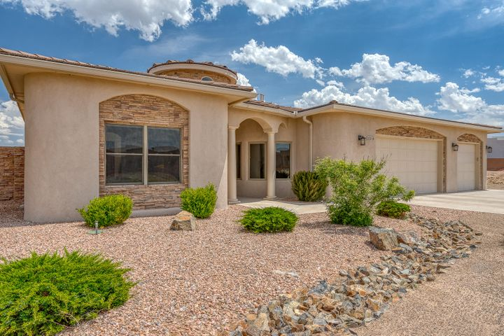 Seller is offering $5,000 towards landscape package! Move In Ready! Beautifully maintained home, Looks Brand New... there's so much to take in,  stunning entry, formal dining and open living area with gorgeous vaulted ceilings, gourmet kitchen all surrounded by walls of windows.  5 nice-sized bedrooms, & 3 full bathrooms. Can't miss high-end finishes, Granite throughout, Stacked stone wall accents, Pella windows and doors, Light cove/soffit feature in master, Diamond Plaster on walls, oversized 3 car garage w/ workshop with Radiant Heat! Home offers two 5 ton Refrigerated Air/Forced Heat Units plus Radiant Heat inside as well. Fully landscaped front yard. Backyard is ready for you to create your dream Oasis...Seller has plans and they are willing to share them with you! Make an appt. TODAY