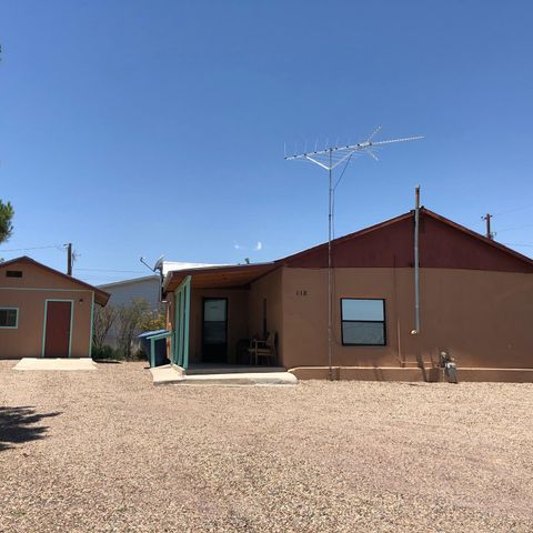 This Charming 2 bedroom , 1 bath  house is just right for  2 or 3 people and close to schools.  Has plenty of privacy and a 12x16 work shop with a concrete floor and electricity.  Property has southwest landscaping with mature trees.  Must see this little home to enjoy it.