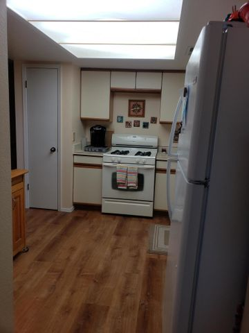 WOW..this is one of the nicest units on the property...Views from the Balcony, vinyl windows w/Shutters, Island in the kitchen, living -dinging L, newer appliances. Storage galore...two nice size bedrooms with walk in closets  One Car Garage...A must seeNO PETS ALLOWED