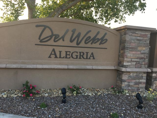 This sunny Del Webb Alegria home has ALOT to offer- Gated community, clubhouse, indoor/outdoor pools,  jacuzzi, full gym, locker room with showers, boccee ball court, walking trails to bosque, 3 activity rooms, zumba, yoga/exercise classes and more.... Home is spacious, clean and  freshly painted with new carpet in bedrooms. Large windows with plantation shutters.  An open floor plan is perfect for space design and your own individual style.  Enjoy a carefree, active and fun retirement; breathtaking  mountain views, private trails to the bosque. Enjoy quiet evenings from private court yards and the beautiful southwestern custom gate. Large corner lot, built-in desk and shelves in office, California style closets, ceiling fans throughout.