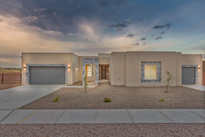 CUSTOM built home in desirable Petroglyph Estates subdivision-NEW CONSTRUCTION-backyard access/RV parking allowed-NO HOA -Perfect for multi-generational families.  Has attached Casita with sink/Refrigerator,  walk in closet and bathroom.  3 bedrooms in the main house with Jack and Jill bathroom perfect for teens/kids, and masterbath boast huge garden tub with his/her closets and sinks.  Quartz countertops throughout home, openfloor plan, large kitchen, 8foot doors, 3 car garage, 4bedroom/3.5 bath-Central air, coffered ceilings in living area.  Great Views of the Sandia right from your living room which is easy to see through the Full wall glass  sliding doors. No Property Disclosure-seller never lived in home-new build!