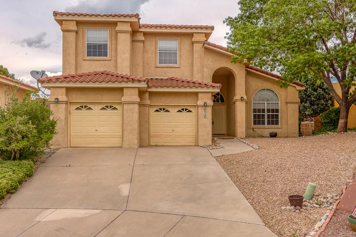 Beautiful home in walking distance to La Cueva High & Desert Ridge Middle School. Open floor plan, features large living room open to kitchen and breakfast area. Separate room with vaulted ceilings could be used as as 2nd living area or study/office. Kitchen has updated granite counter tops, ceramic tile floors, tile back splash, and breakfast bar. Master bedroom  with updated bath, large tiled shower & balcony with mountain views. Additional bedrooms with Jack-n-Jill updated bathroom. Fully landscaped F/B. Nice retaining walls in back yard.