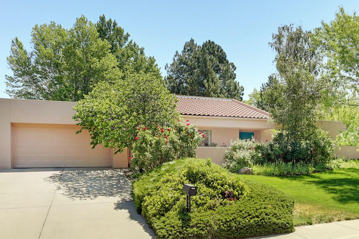 **Open House Sunday July 14th from 2-4pm** If you are looking for a lot of home for the money in Albuquerque's honey spot, you've found it! This well taken care of one story home is located on a lush, park-like lot with mature trees and grass in the front and back. The spacious kitchen has lots of cabinet / counter space, a large walk in pantry, and is perfect for entertaining with it's large center island. The spacious master suite has it's own sitting area and private bath with a sunken jetted tub, double sinks and a shower. Refrigerated air, 2 covered patios, and an oversized garage are just a few of the many wonderful features you will find here. Radon / Home / Sewer Line / Duct / Termite & dry rot inspections complete. Price reduced & being sold ''As-IS''. No showings till after OH.