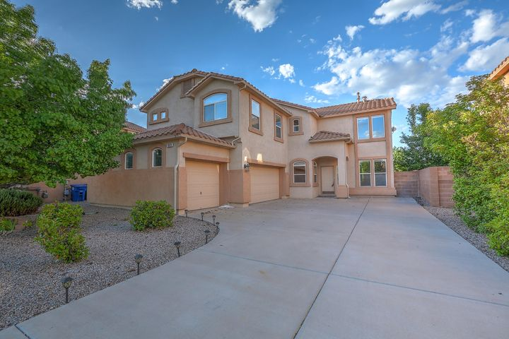 New carpet throughout as of 6/7/19 Beautiful home in sought after neighborhood has room for the growing family. Main level features formal living and dining, office/flex room, huge great room with soaring ceilings, stunning stone fireplace, breakfast room, open kitchen with island, gas cook top, electric oven, and large walk-in pantry. Gorgeous wrought iron spindle staircase leads up to 4 spacious bedrooms plus bonus room. Grand owner's retreat is a wonderful place to relax and unwind. Master bath with double sink, garden tub separate shower and enormous walk-in closet. Low maintenance landscaping front and back.3 car garage. Refrigerated Air. Enjoy the walking trails and 3 lush parks in the peaceful subdivision with the best seats for balloon fiesta viewing Vista Del Norte at its finest