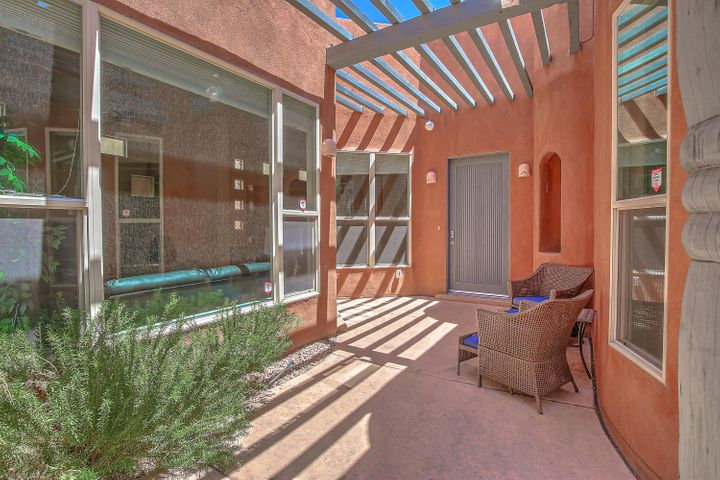 Fabulous contemporary, one story  pueblo home with views to die for, in the gated  Desert Mountain community in High Desert. . There is also a 2 story casita with it's own garage. The kitchen has been beautifully remodeled, the home  is freshly painted  and the roof was replaced in 2018. It is turn key and is in move-in condition. The backyard, living room and dining room have gorgeous, unobstructed views of the Sandia Mountains. There are lovely, custom touches throughout the home, including tongue and groove ceilings, lovely cabinetry and two fireplaces. There is also a community pool to enjoy in this private, peaceful enclave.