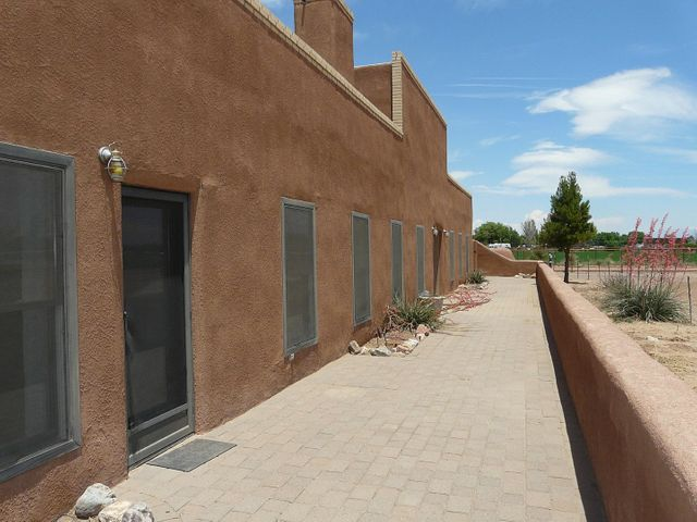 Serious Horse Property with eclectic true double adobe home!  Roof, HVAC and leach field are all one year old!  This amazing home has so much character, high ceilings, saltillo tile floors, gorgeous sunroom (283 sf not included).  Huge kitchen with professional gas stove, granite counters, tons of storage, large eating area, then enter the living/dining area which is huge and the pellet stove stays with the right offer!  The second bedroom and master bedroom are accessed via doors from the living area.  Two spacious bathrooms with tubs and separate showers.  Garage with exposed adobe walls has two car door but is four cars large!  Add your adobe barn with stalls and runs, giant turn out, a smaller barn and shed, planted field with ditch irrigation, peace and quiet!  Yummy property!!!
