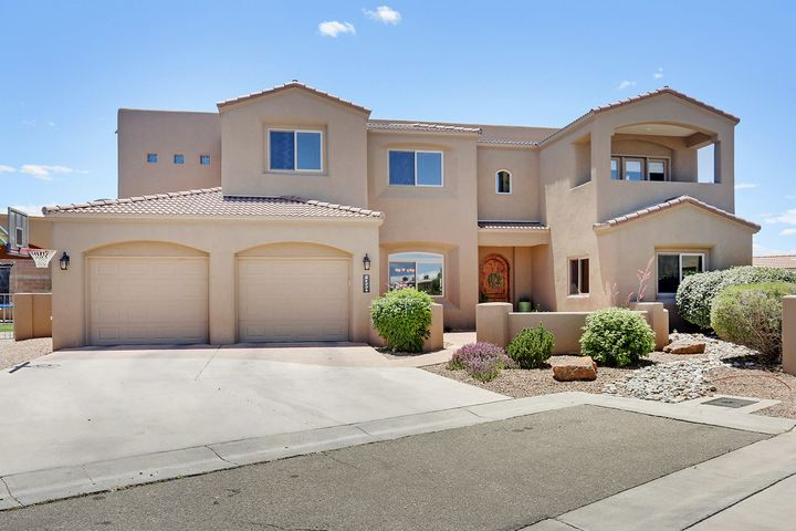 Don't miss this beautiful home in one of the most sought after areas of ABQ! Quiet neighborhood yet convenient to amenities & I25. This open floorplan is light & bright! Large main living area with custom gas fireplace. Gourmet kitchen bodes stainless appliances, solid surface counters, custom tile backsplash, an island, & walk-in pantry. Master retreat features a sitting area, walk-in closet, private balcony with sunset & city views, luxurious bath with custom tile shower, double sinks & jetted tub. 2 nicely sized secondary bedrooms and bath upstairs, 1 bed and bath down~ great for guests or office. Functional loft with a balcony~ mountain views. Lovely backyard is great for entertaining! 3 car garage (tandem), huge laundry room, wired for surround sound and so much more.  Welcome home!