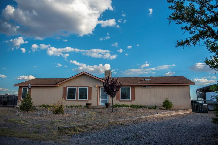 Welcome to this beautiful home located in a quiet cul de sac with views all around. Master bedroom and bath situated opposite of other two bedrooms. Two living areas with natural sunlight throughout.  This home backs to open space with miles and miles of views - sunsets and mountains.   This home has been meticulously maintained with updates such as - custom kitchen and laundry room cabinets 2013, Pex plumbing installed throughout entire home 2013, triple pane windows and sliding glass door 2015, covered porch 2014, Eagle metal shed 2013.  Backyard fully enclosed with cinder block wall and gates on both sides of yard. Backyard Access with RV pad and covered Eagle carport installed 2016.  This home has a fabulous layout with all the right spaces and is move in ready! Come see!