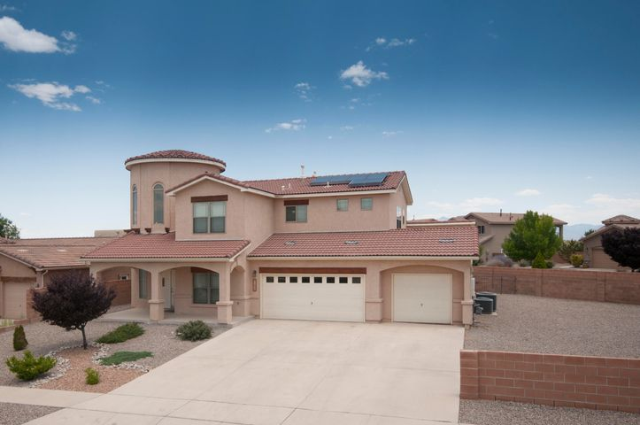 Spacious Wallen built 2 story 4BR/3.5BTH 3050 Square Foot home on large 0.27 acre corner lot at the top of the hill in Loma Pinon!  This home is splendid with its solid surface tile and high end laminate flooring throughout (no carpet,) 19.5 foot ceilings in the living room, grand foyer, formal dining room, downstairs master suite with luxurious master bath, 3 bedrooms plus a loft upstairs (with 2 bathrooms,) view balcony, 3 car garage, and dual zone refrigerated air.  Nice front and backyard landscaping including artificial turf.  Solar system is installed and is transferable.  This community does not have an HOA and it appears that backyard/side yard access is possible to store some toys!!