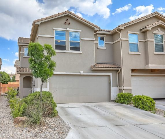 Beautiful townhome in gated community close to Kirtland AFB. Open floor plan with tons of natural light. Large kitchen, granite counter tops, and full appliance package. Updated tile flooring and laminate hardwood. Enjoy the private backyard with over sized patio and firepit. Brand new A/C unit just installed June 2019. Must See!