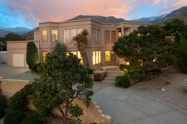 Gorgeous OMEGA custom home in GLENWOOD HILLS NORTH! This great family home offers amazing MOUNTAIN & CITY VIEWS! Close to the OPEN SPACE, this beautiful custom home has 4 bedrooms and 2 3/4 bathrooms. Enter the house at the light and bright welcoming foyer, and you will find the spacious living room with clearstory windows. Kitchen with lots of counter space offers a huge island for entertaining. The big family room has a fireplace for your cozy winter nights and open to an extra space that you can as a play room, studio, or workout room. Go upstairs and you will the master suite with a balcony. Other rooms on this level all have balcony access and great views!  The huge backyard is close to the OPEN SPACE and has big open & closed patios!