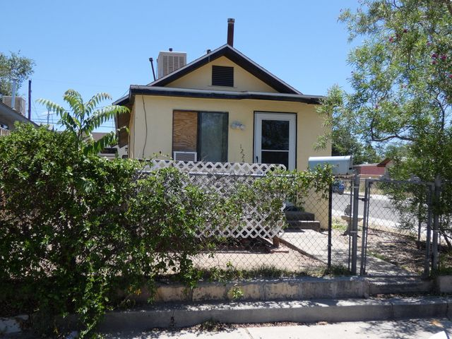 Nice corner lot, Enjoyable deck in front, roof and windows only one year young, two bedrooms, one bath, back yard access with gate and curb cut, storage shed, washer and dryer included.  Home needs TLC.