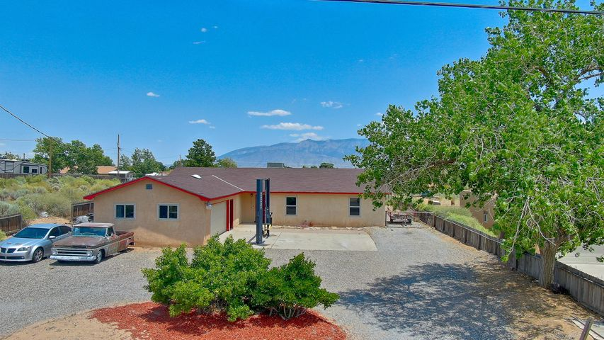Large, open floor plan with many updated features. Wood flooring throughout great room and bedrooms. Tile flooring in kitchen and dining rooms. Huge bonus room could be used as a family room or 4th bedroom. Amazing views of the Sandia mountains from the backyard. Full 1/2 acre of usable, fully-fenced, and private land.