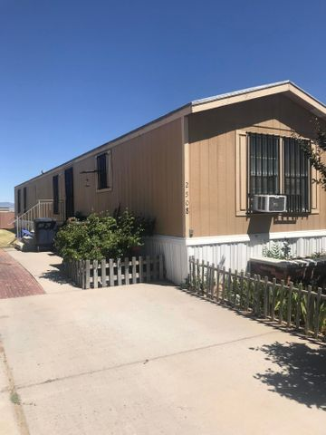 Currently located in SW Albuquerque, this well kept 3 bedroom, 2 bath mobile home is ready for a new owner.  Home is currently on leased lot but can be moved or new land lease can be signed with leasing office.  Seller is selling as is.  Home features wrought iron security all around, cathedral ceilings, recently remodeled bathrooms, and new kitchen vinyl flooring.