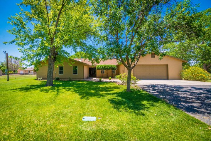 Beautiful home in great location!  Two tracts of land come with this property totaling 2.08 acres. Flooring is laminate, tile, wood, and brick. Large rooms, custom oak cabinets.  Sun Room could be art studio.  Updated bathrooms.  Outdoor patio/gazebo approximately 1,400 sq ft was built for outdoor entertaining with lights, fans, half bath, top of the line grill, 2-burner stove. Property has MRGCD irrigation rights. Peaceful country setting yet close to all City conveniences!