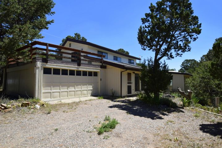 Located in highly desirable Sierra Vista Estates, almost across the street from Milly's Meadow, this passive solar home is ready for new east mountain owners.  Fairly new kitchen appliances will attract the best in country chefs.  A large (17' X 11'') hobby/laundry room offers much potential for exercise equipment or gardening.  Downstairs there is a huge living area with total brick floors, upstairs is a second bedroom and a potential third loft area with a walk out patio (20' X 20') over the garage for relaxing  and enjoying the surrounding views and wildlife.  What a nice place to take in the sun rises daily.  Come on out to the green side of the mountain and make your dreams come true with maybe fresher pine air, and a little peace and quiet away from the big city noise.