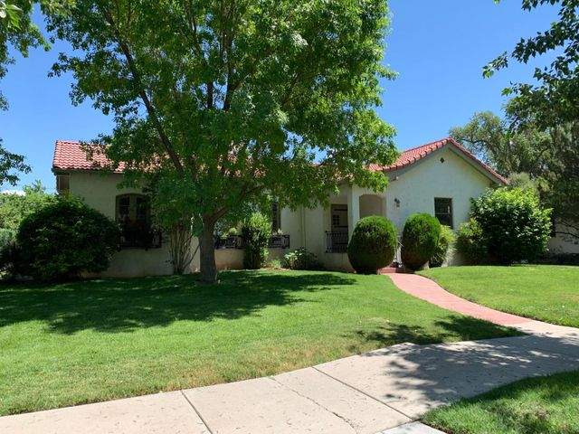Pride of ownership shines in this elegant, impeccably maintained, spacious 5 bedroom home in highly desired Huning Castle - ABQ Country Club neighborhood.  Amazing renovation and modernization of the entire home while maintaining the original architectural charm & vintage features created by Baldridge in 1929.  Numerous amenities include:  Barrel-vault ceilings in the living room & dining room, arched windows & doorways, nichos, stunning hardwood floors, gourmet kitchen, gorgeous custom cabinetry throughout, charming vintage bathrooms, a cedar closet, luxurious master bedroom with private patio & bath with steam shower, abundant storage, lush landscaping with 2 fountains on large lot, automatic gate for detached 1 car garage & extra parking, large covered patio & 75 gallon water heater.