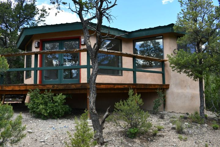 Two room straw bale casita with views that will make your soul soar.  No bath or kitchen yet, just good feeling space with views everywhere.  Large spacious deck.  New owner will need to add an electric and water meter, driveway, and a septic system.  All this on just over half an acre!