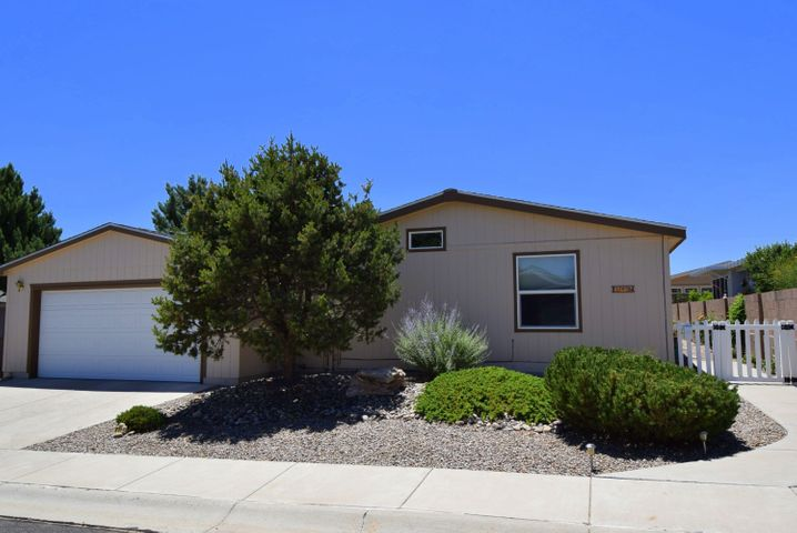 Gated 55 plus community, very well maintained on a double lot with a huge 12x24 sun room attached. 3 bedroom 2 full baths, open floor plan with 2 living areas, kitchen with island, gas fireplace. Ceiling fans throughout the property, added light with skylights!  Master bedroom separated from the other bedrooms with garden tub and separate shower. Amazing private backyard with fruit trees and plants. Private gated 55 plus community with club house and private indoor pool, activities and gated!