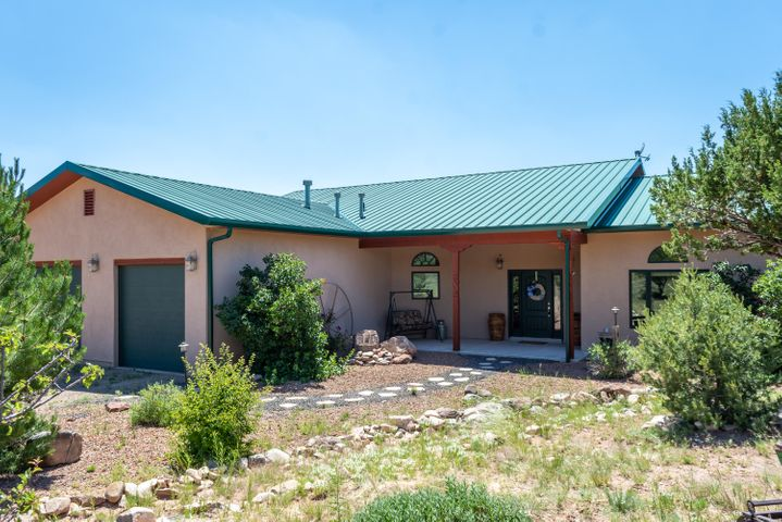 Awesome Horse Property or Country Estate!Charming Northern New Mexican Custom Home Situated on 15 Acres at the Base of South Mountain! Cook's Dream Kitchen with hickory cabinets, granite counter tops and stunning island.  Split Master Bedroom offers a personal retreat with jetted tub, separate shower and double, separated vanities. Two large additional bedrooms share a ''Jack & Jill'' bathroom. This Home has an Open Floor Plan with a custom Rock FP in the Great Room. The Study could be the 4th bedroom, if needed. The Backyard is Lushly Landscaped with Flower Gardens, Fire pit and Outdoor Kitchen for Entertaining or spending quality family time! The Views are incredible, gorgeous city lights when night falls!  Full RV Hook-up and a 52X70 Barn!!! Can be Purchased with an additional 10 acres.