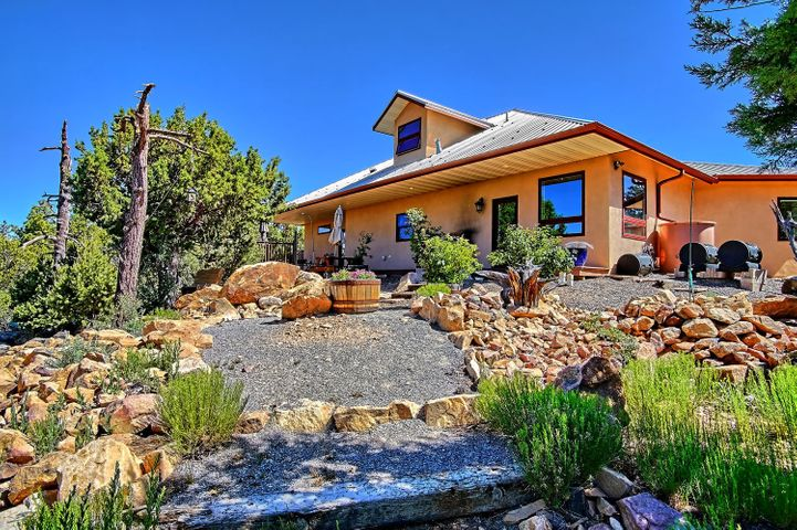 Fabulous 8 acre mountain retreat!  Beautiful mountain home with spectacular and endless views! Homeowners have spared no expense on this super energy efficient ICF constructed home! Once you enter into home, you're greeted by so many custom designs,  stone wall  entry into home, raised hearth w/wood burning stove, variance plaster walls, Huge great room with 17 foot ceilings, open floor plan. Gorgeous kitchen with granite countertops, stainless steel appliances, soft close custom cabinetry! Cork flooring for extra comfort.  Beautiful master bath with walk in snail shower,  custom tile work throughout, granite countertops.  Trex decking right off master bedrm, for your view enjoyment! Pella windows and exterior doors.  Over 700 sq.ft. outdoor living space, solar panels  and so much more!