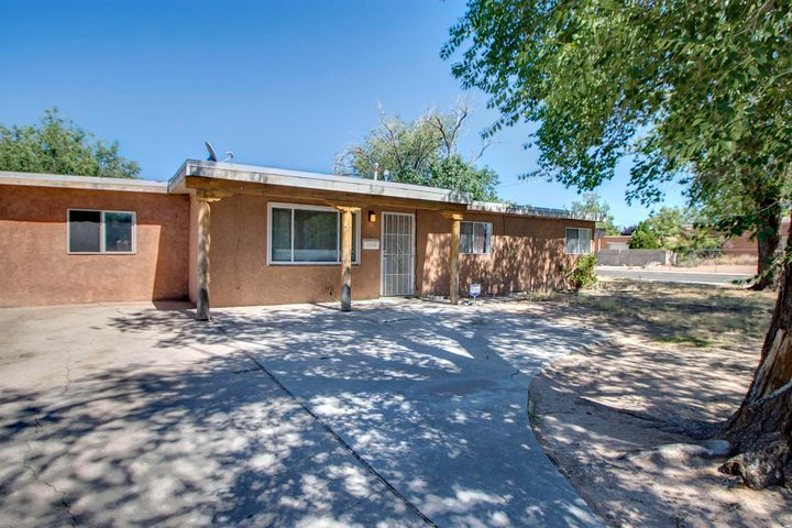 Great location in the heart of Albuquerque! 4 bedroom, 2 bathroom home on a corner lot with back yard access for all of your toys!Cozy living room open to the eat-in-kitchen. The kitchen has been updated with cabinets and counter tops. The master bedroom has a large walk in closet and a full bathroom. The fourth bedroom can be a studio with lots of space and an entrance from the outside. The other two bedrooms are spacious. The back yard has plenty of space with a large covered deck, a dog run, a shed, and back yard access! This is a great home to entertain in.