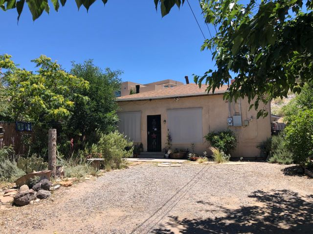 Come view this cozy home located on a limited-access cul-de-sac near UNM, Downtown, and Old Town.  Enjoy the comfort of high efficiency gas furnace and refrigerated air. New Water Heater, New Water Main, and New Roof!