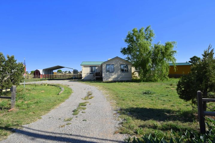 Perfect starter home on 3/4 acre with fenced area for horses.  Open style kitchen, large living room, 3 bedrooms, & 2 bathrooms. There is an addition that can be used as a 2nd living area or 4th bedroom.  Backyard features large deck for great outdoor living.  There are 2 attached sheds on the back of property and a 3rd shed next to the barn that can be used as a tack room.  Don't miss out on this great deal!