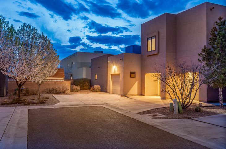 Contemporary Masterpiece! This Wilder home is located in the Villas Las Mananitas community just off Rio Grande! Ultimate Sophistication--Helmick built it with flair and distinction! It includes custom oxidized copper lighting created by Santa Fe artist-Michael Lancaster. Voluminous great room is an Entertainers Delight with stained concrete floors, raised ceilings, gas fireplace, wet-bar, surround sound and a wall of glass doors with outside access. The ultimate Chef's kitchen includes custom Birch cabinetry, large custom island, stainless steel appliances, 6 burner cooktop, 2 dishwashers, range hood, copper sink. Master on 1 floor with patio door, double shower and built-in Walnut shelving in huge walk-in closet. Concrete flooring on lower level, custom Walnut hardwood on 2 level.