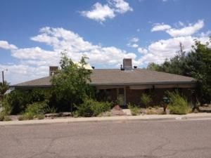 Room to spare.  Located in an established neighborhood. Close to New Mexico Tech. Invest in this spacious brick veneered home, sitting on a corner lot.  20 x 20 workshed with electricity.