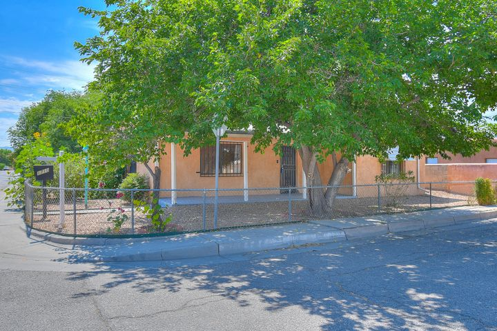 Open House: 8/15 from 4-6 pm. Welcome to this wonderfully located Old Town Home! Lots of character and spacious living. You'll love the corner lot giving you more privacy and less neighbor noise. Thoughtfully maintained this home is sure to catch your eye and make you want to stay. Great location for Air BnB!!!  It has side yard access for parking cars and/or RVs. Schedule a showing, today!  Walking distance to Tiguex Park, Old Town and Museums.  Minutes from downtown & freeway access. Don't let this one get away!