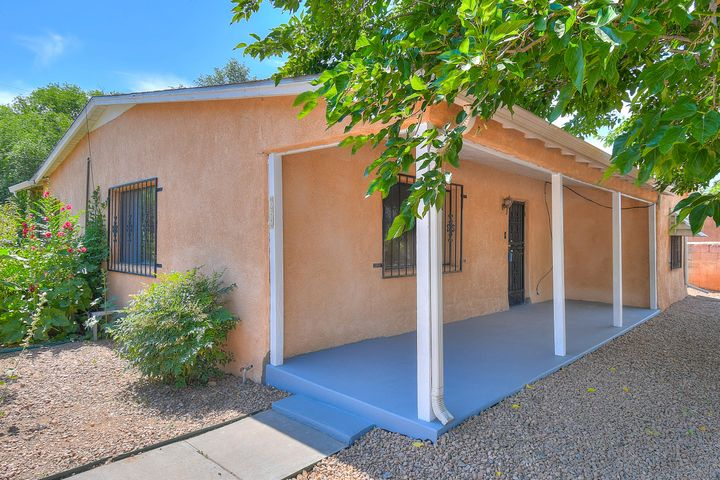 Open House Saturday 11/16 12-2pm. Welcome to this wonderfully located Old Town Home! Lots of character and spacious living. You'll love the corner lot giving you more privacy and less neighbor noise. Thoughtfully maintained this home is sure to catch your eye and make you want to stay. Great location for Air BnB!!!  It has side yard access for parking cars and/or RVs. Schedule a showing, today!  Walking distance to Tiguex Park, Old Town and Museums.  Minutes from downtown & freeway access. Don't let this one get away!